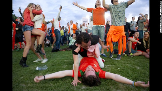 Dutch fans cheer in Amsterdam, Netherlands, after watching their soccer team demolish Spain 5-1.