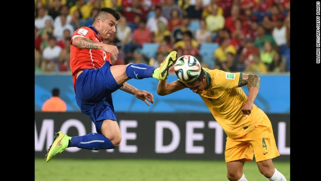 Australian forward Tim Cahill, right, and Chilean defender Gary Medel vie for the ball.
