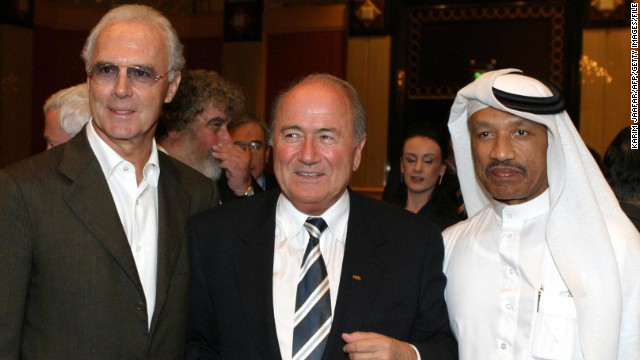 Franz Beckenbauer (L) with FIFA president Sepp Blatter (C) and Mohammed bin Hammam, at a 2003 FIFA Congress in Qatar.
