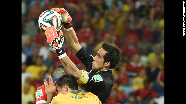 Chile goalkeeper Claudio Bravo saves the ball.