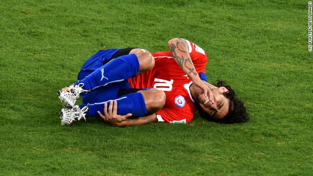 Jorge Valdivia of Chile lies on the field after a foul.