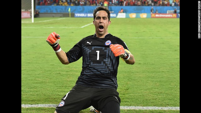 Goalkeeper Claudio Bravo of Chile celebrates after his team scored at the end of the match against Australia on Friday, June 13. Chile won 3-1. Friday was the second day of the soccer tournament, which is being held in 12 cities across Brazil. <a href='http://www.cnn.com/2014/06/12/football/gallery/world-cup-0612/index.html' target='_blank'>See Thursday's best photos</a>