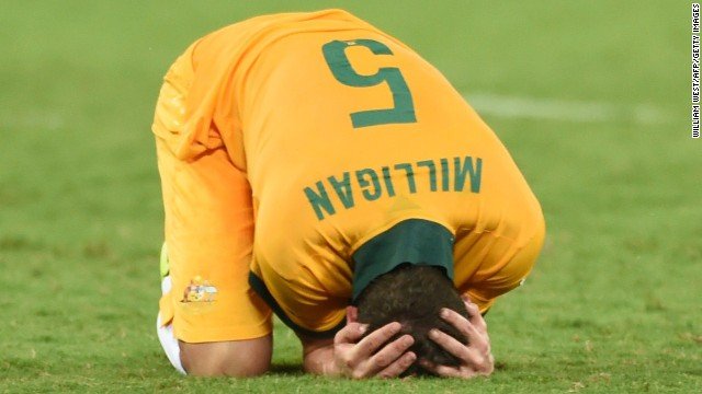 Australia midfielder Mark Milligan reacts to the score.