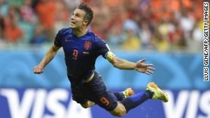 Netherlands forward Robin van Persie scores against Spain.