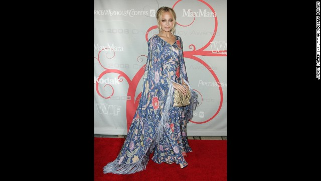 Nicole Richie wears a caftan on the red carpet in 2008. Today's caftans are much more elaborate in terms of pattern and embellishment and more tailored to highlight the feminine silhouette. Still, the essential structure of a T-shaped garment that reaches the ground remains the same.
