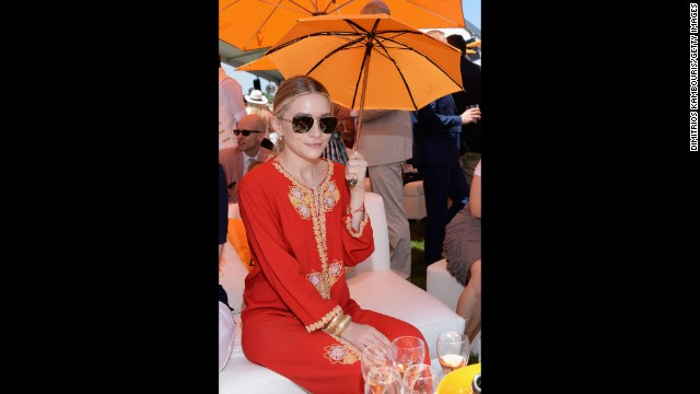 "Ashley Olsen wears a vintage caftan in 2013. Frocks resembling caftans first appeared in modern Western fashion in the 1920s when European designers such as <a href='http://www.britannica.com/EBchecked/topic/466443/Paul-Poiret' target='_blank'>Paul Poiret</a> began <a href='http://www.britannica.com/EBchecked/topic/466443/Paul-Poiret' target='_blank'>experimenting with ""Orientalist"" looks</a>, departing from fitted, tailored styles of the Victorian era in favor of draped pants and tunics."