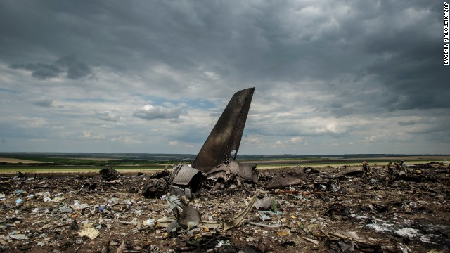 Debris lies scattered at an airport in Luhansk, Ukraine, on Saturday, June 14, after the crash of a Ukrainian Ilyushin-76 military transport plane. A military spokesman said the aircraft was shot down by pro-Russian separatists, killing all 49 aboard.