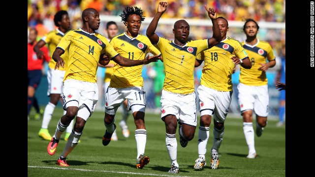 Pablo Armero of Colombia, center, celebrates with teammates after scoring the opening goal.