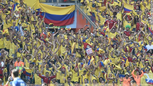 Colombian fans cheer from the stand.