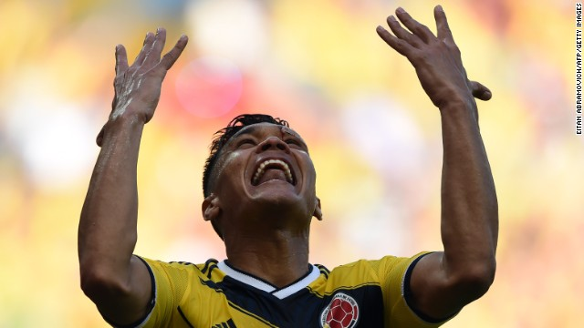 Colombia forward Teofilo Gutierrez celebrates after scoring his team's second goal against Greece.