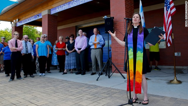 Pastor Carol Hill from Epworth United Methodist Church speaks during a beachfront marriage equality ceremony at the Kathy Osterman Beach in Chicago, on Sunday, June 1, 2014. June 1 marked the first day that all of Illinois' 102 counties could begin issuing marriage licenses to same-sex couples.