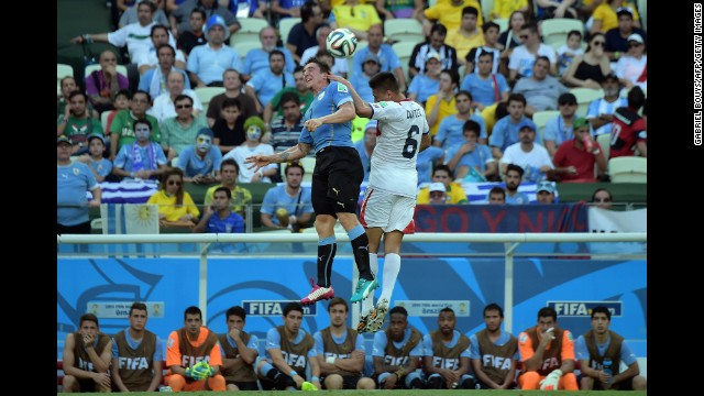 Costa Rica defender Oscar Duarte, right, and Uruguay midfielder Cristian Rodriguez vie for the ball.
