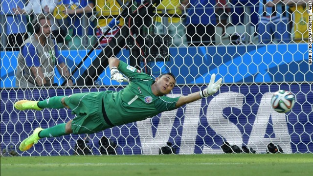 Costa Rica's goalkeeper Keylor Navas fails to save Edinson Cavani's penalty kick.