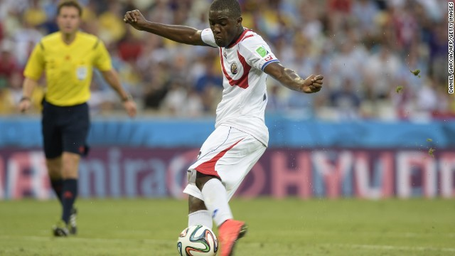 Forward Joel Campbell scores Costa Rica's equalizer against Uruguay.