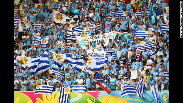 Uruguay fans hold up their country's flags before the game.