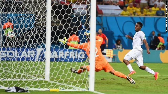 Striker Daniel Sturridge equalizes for England against Italy, beating goalkeeper Salvatore Sirigu.