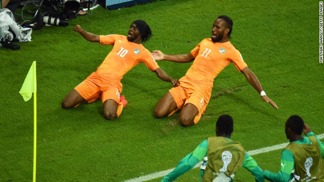Gervinho of the Ivory Coast, left, celebrates scoring his team's second goal with teammate Didier Drogba during the World Cup match between the Ivory Coast and Japan at Arena Pernambuco on June 14 in Recife, Brazil. Ivory Coast defeated Japan 2-1. It was the third day of the tournament, which is being held in 12 cities across Brazil. <a href='http://www.cnn.com/2014/06/13/football/gallery/world-cup-0613/index.html' target='_blank'>See Saturday's best photos</a>
