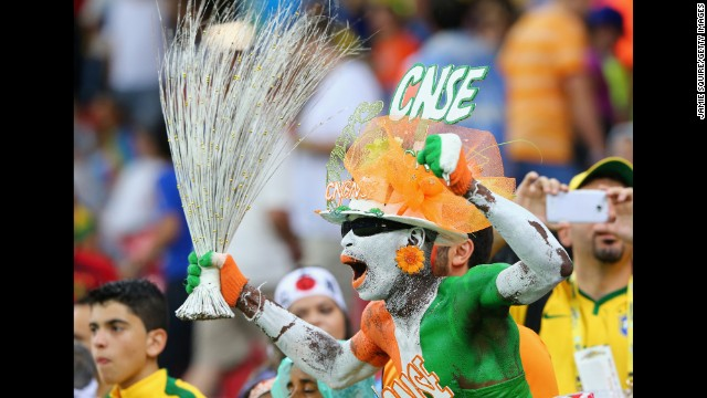 A fan of the Ivory Coast cheers in the crowd during the match.