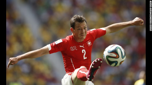 Switzerland defender Stephan Lichtsteiner plays the ball.