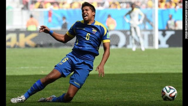 Ecuador midfielder Christian Noboa falls to the ground in apparent anguish.