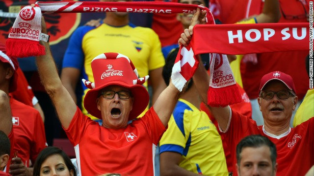Swiss fans cheer and hold up banners during the game. See the best World Cup photos from June 14.