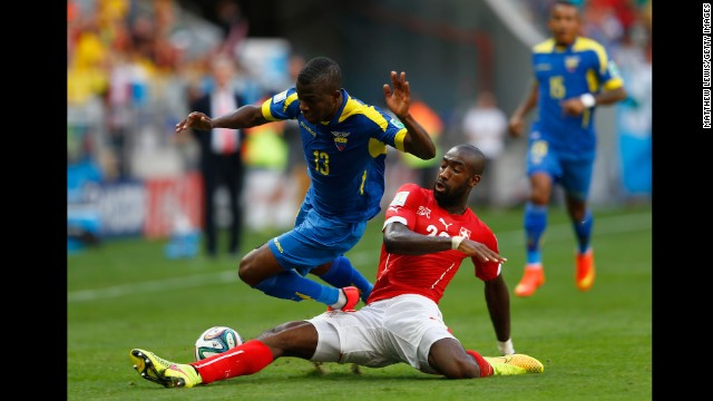 Johan Djourou of Switzerland tackles Enner Valencia of Ecuador