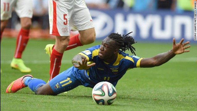 Ecuador forward Felipe Caicedo appeals for a free kick as he falls on the pitch.