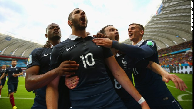 France forward Karim Benzema, second left, celebrates with teammates after scoring his team's first goal against Honduras with a penalty kick.