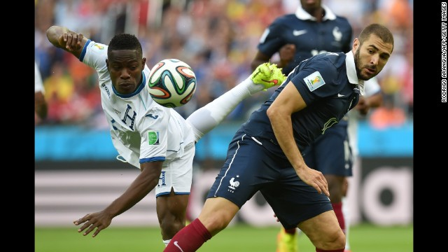 Honduras defender Maynor Figueroa, left, vies for the ball with France forward Karim Benzema.