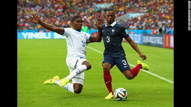 Brayan Beckeles of Honduras challenges Patrice Evra of France.