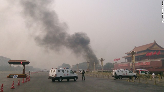 Smoke rises from the scene of a fatal car crash attack in 2013 at Tiananmen Square.
