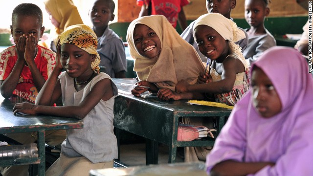 Children pose in a classroom at the Friendship Primary school in Zinder, Niger, on June 1, 2012.