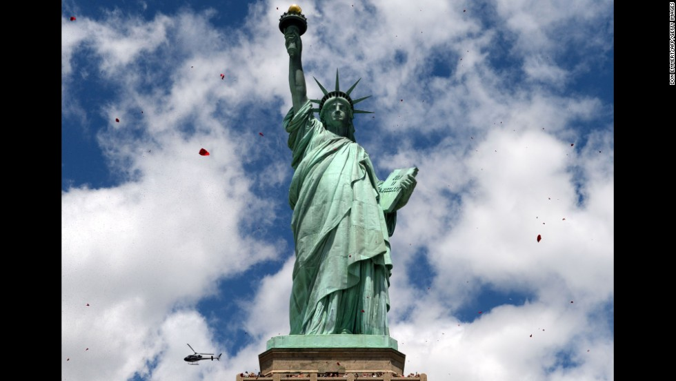 Rose petals fall from a helicopter around the Statue of Liberty on June 6 in New York City. On June 17, 1885, the historic monument arrived in New York in 350 pieces.