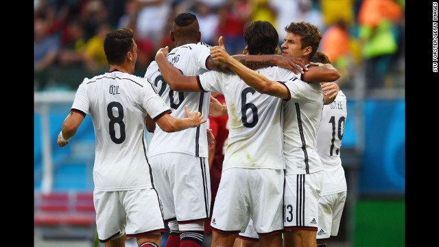 German players celebrate after Mueller, right, converted a penalty kick to open the scoring.