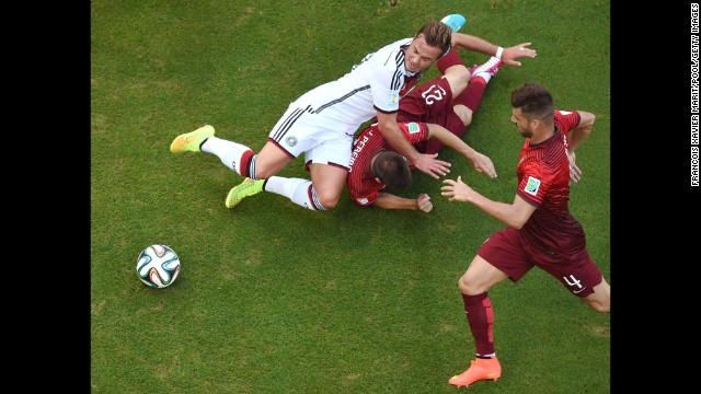 The penalty kick was awarded after Portugal's Joao Pereira, center, fouled Germany's Mario Goetze.
