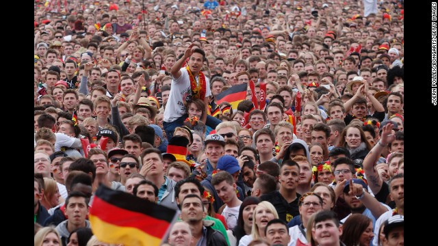 Fans gather in Hamburg, Germany, to watch the game. See the best World
