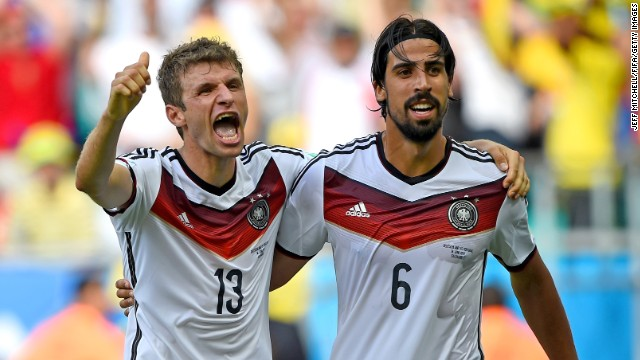 Germany's Thomas Mueller, left, celebrates with Sami Khedira after scoring his team's fourth goal. Mueller scored three of Germany's goals.