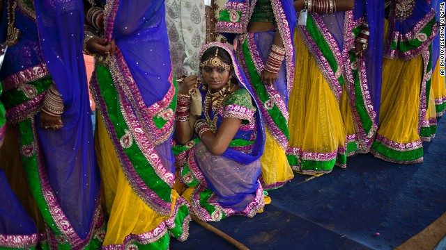 JUNE 16 - NEW DELHI, INDIA: A physically disabled bride waits in line during a mass wedding held by a nongovernmental organization for impoverished couples. Such events are organized to help families who cannot afford the high ceremony costs and the dowry that is customary in many communities.