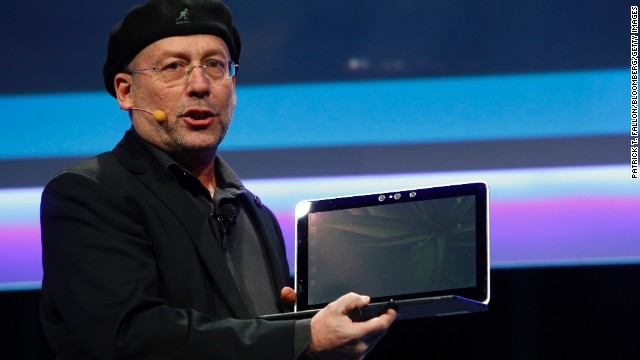 "Glasses-free 3-D is now spreading to other portable devices. Shmuel ""Mooly"" Eden, senior vice president at Intel Corp., holds up a laptop computer with an embedded 3-D camera during a news conference at the 2014 Consumer Electronics Show in Las Vegas."