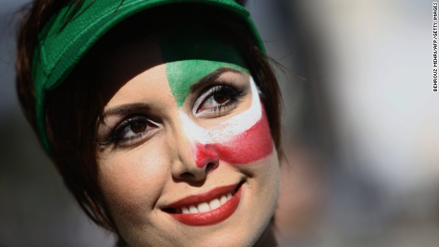 An Iran fan is seen outside the stadium.