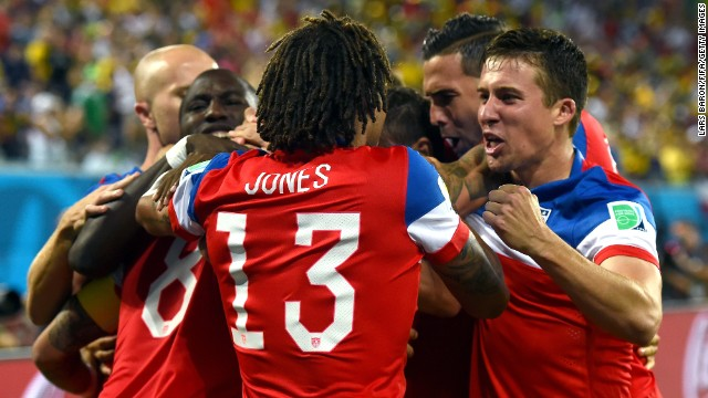Jones and other American players celebrate together after Dempsey scored the first goal of the game.