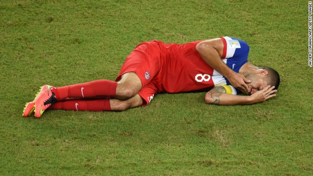 Clint Dempsey of the United States lies on the ground after he was kicked in the nose during a play in the first half.