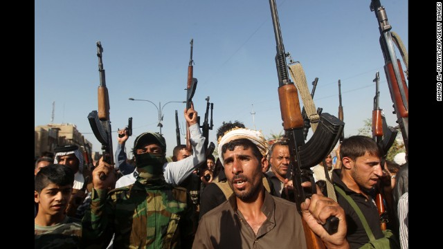 Iraqi tribesmen gather in Baghdad on Monday, June 16, to show their readiness to join Iraqi security forces in the fight against Islamic militants.