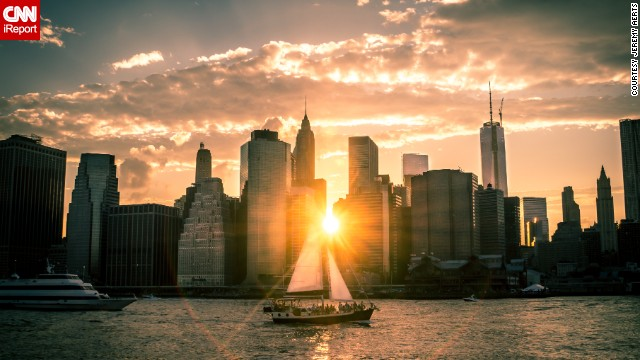 The sun drifts below the New York City skyline on a late June evening. <a href='http://ireport.cnn.com/docs/DOC-1140686'>Jeremy Aerts</a> found the perfect spot to drink in the view of the East River at Brooklyn Bridge Park.