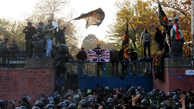 Protesters prepare to break in to the British Embassy on November 29, 2011 in Tehran, Iran.