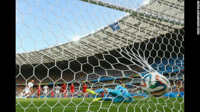 A behind-the-goal angle of Feghouli's first-half score. The penalty kick was awarded after Feghouli was fouled in the box by Belgian left back Jan Vertonghen.