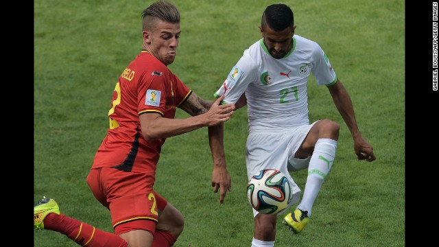 Belgian defender Toby Alderweireld, left, vies for the ball against Algeria's Riyad Mahrez.