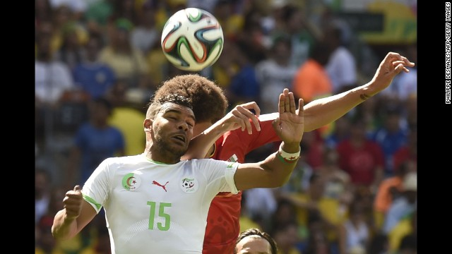 Soudani, left, goes for a header against Belgium's Axel Witsel.