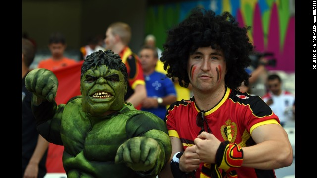 A Belgium fan and a man dressed as the Incredible Hulk pose for a photo before the match. <a href='http://www.cnn.com/2014/06/16/football/gallery/world-cup-0616/index.html'>See the best World Cup photos from June 16. </a>