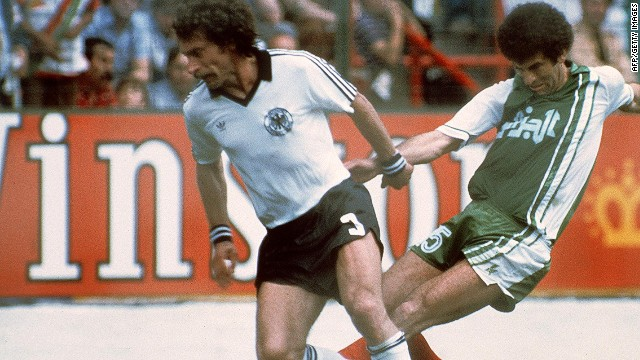 """Out, Out"" chanted the fans as West Germany and Austria ensured their second round qualification in 1982. West Germany's 1-0 win over Austria sent both sides into the knockout stages at the expense of Algeria."